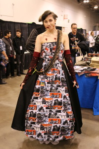 A cosplayer with a beautiful dress made out of pages from The Walking Dead comic book