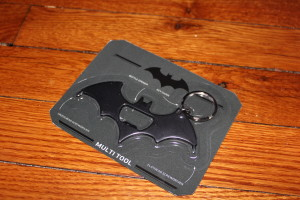 Batman Multitool Keychain from Paladone. It has a bottle opener, and both a flathead & Phillips screwdrivers on the outer wings.