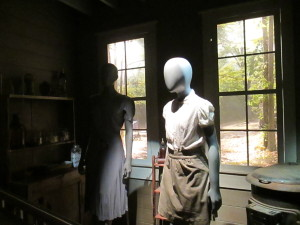 The Everdeen home in District 12, featuring costumes for Katniss and Prim.
