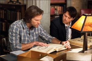 Supernatural 11.14 - Sam and Lucifer look at a book for ways to rescue Dean.