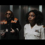 Good Omens deleted scene where Crowley and a cell tower employee ride the elevator up to the control room. Crowley is wearing his signature orange mischief-causing jacket and carrying a stainless steel thermos