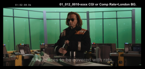 Good Omens Deleted Scene where Crowley stands in the middle of the cell tower control room. He is wearing his late aughts hair and sunglasses along with his orange high-viz work jacket. He is in the middle of pouring coffee into a thermos cup.