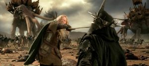 "Eowyn, dressed as Rohirrim soldier, ""Dernhelm"" stands on an epic battlefield, lunges forward, and stabs the Witch King of Angmar in the face seconds after declaring ""I am no man"""