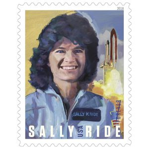 A stamp featuring a painting of Sally Ride with a spaceship lifting off in the background